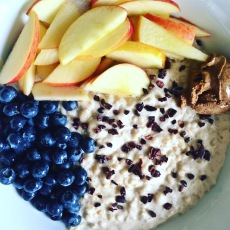 Oatmeal, fruit, nut butter and cacao nibs :D